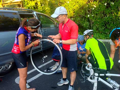 Garry helping me inspect the tire. Photo credit: Pim Kunakasem.